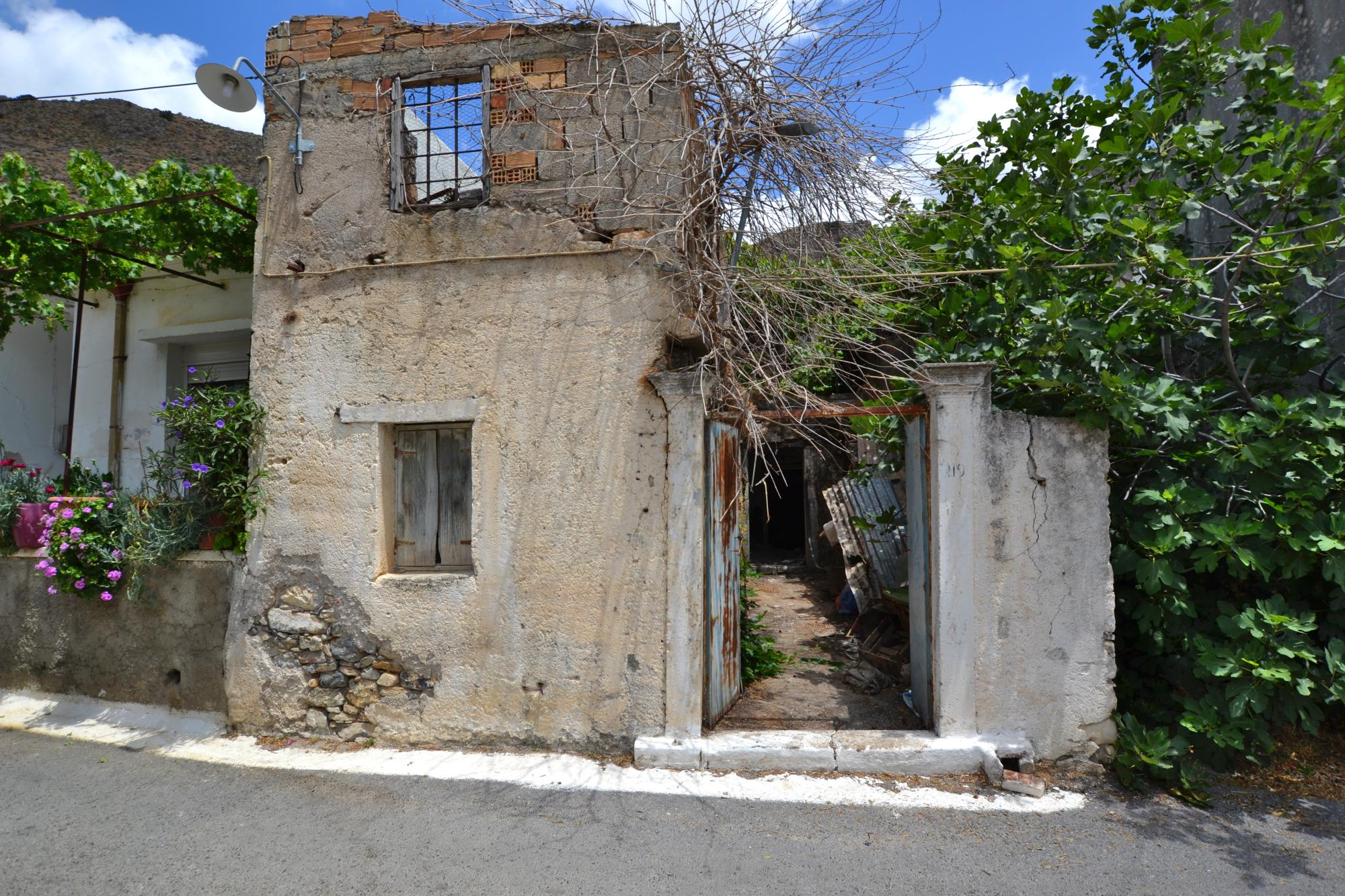 Old stone house with patio for renovation for sale in Limnes, Agios Nikolaos, Crete.