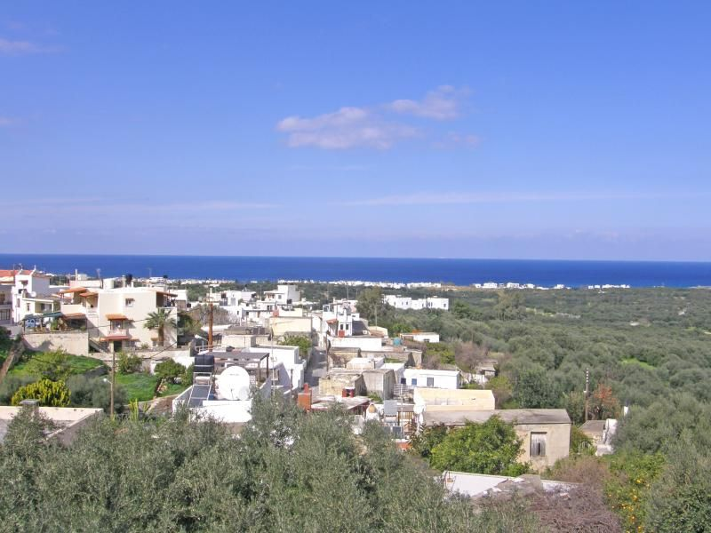 Plot of land with sea views in picturesque village.