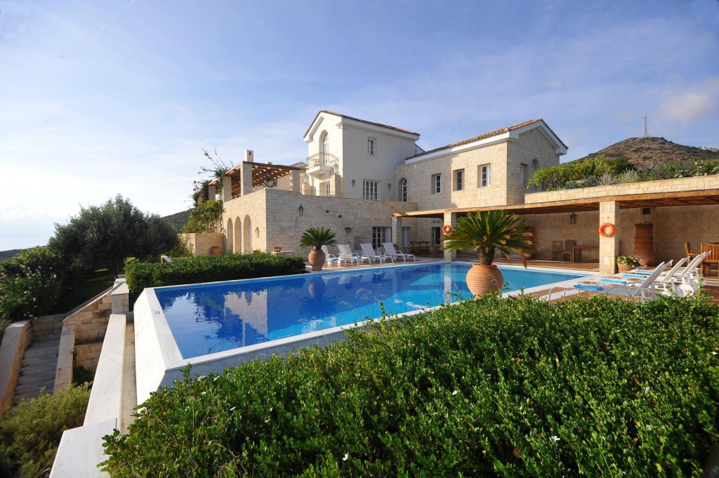 Sea-front luxury villa with pool, tennis court and established gardens.