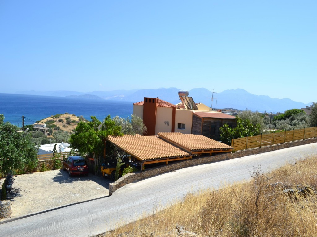 4 bedroom villa with 3 studio apts, sea views, close to town and beach.