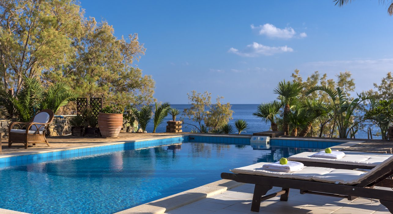 Seaside 4-bed villa with pool, private bay and great revenue potential.