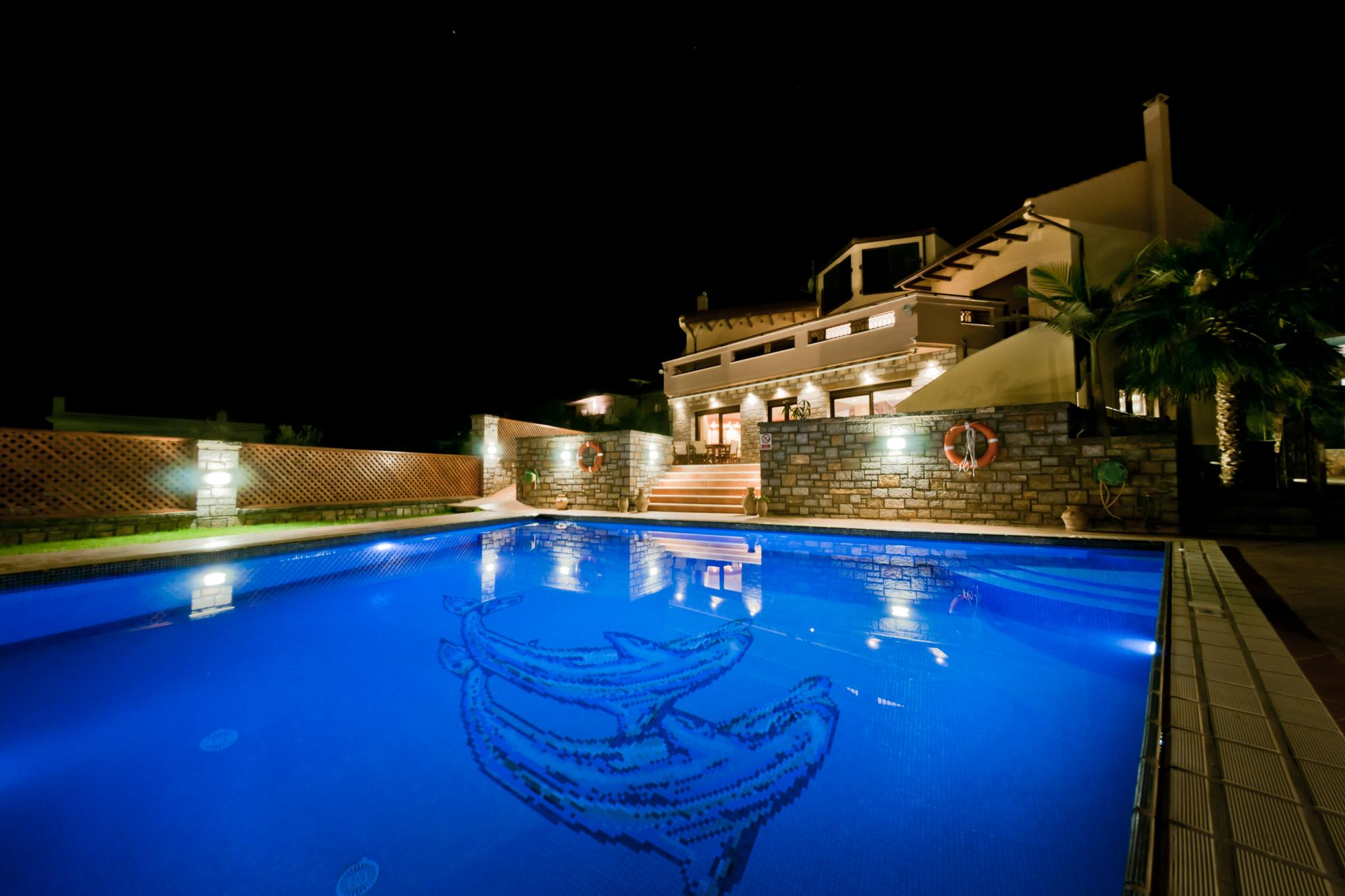 Luxurious 4 bedroom villa with pool, gardens and sea views.