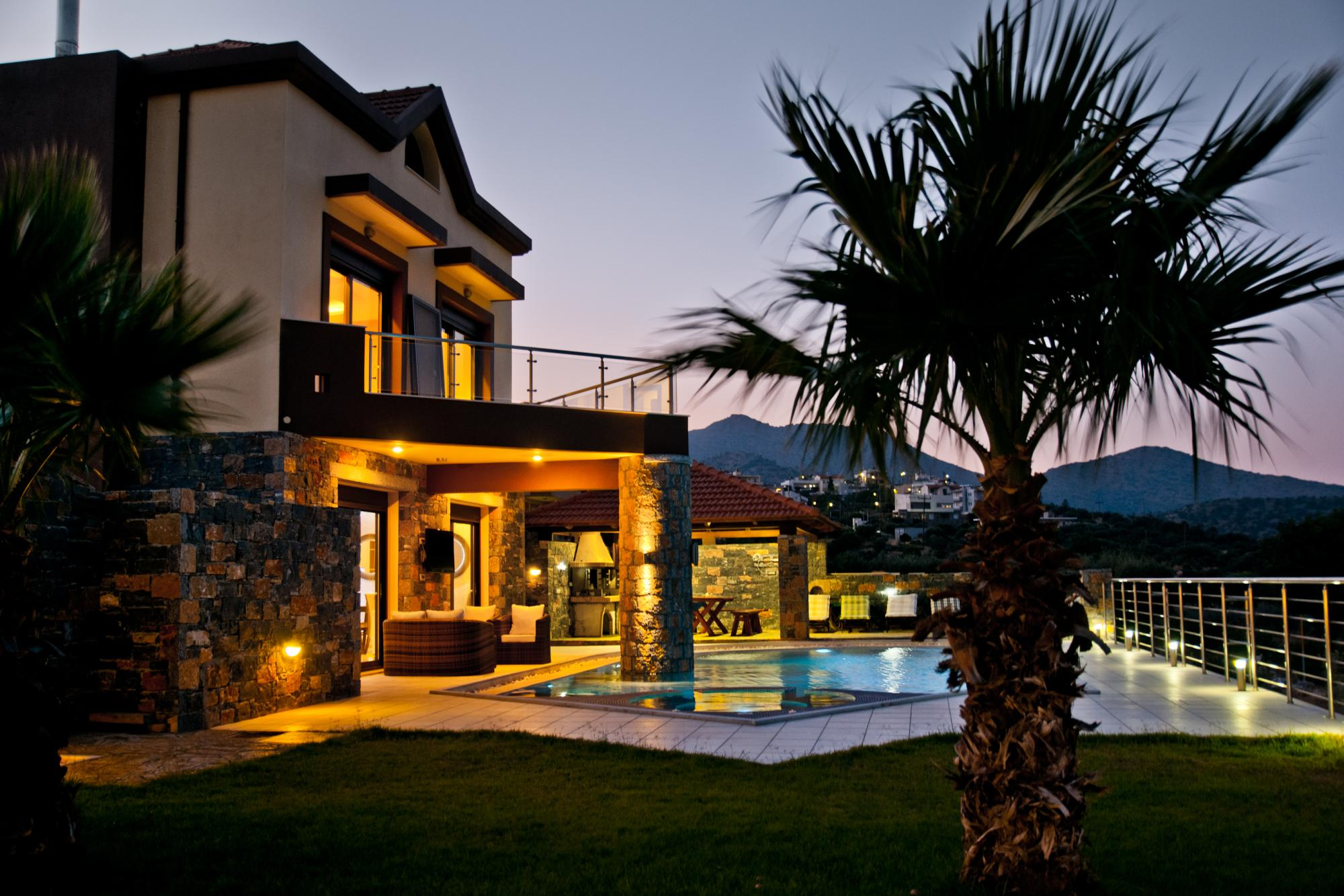 Luxurious villa with swimming pool and great sea views on outskirts of cosmopolitan town.