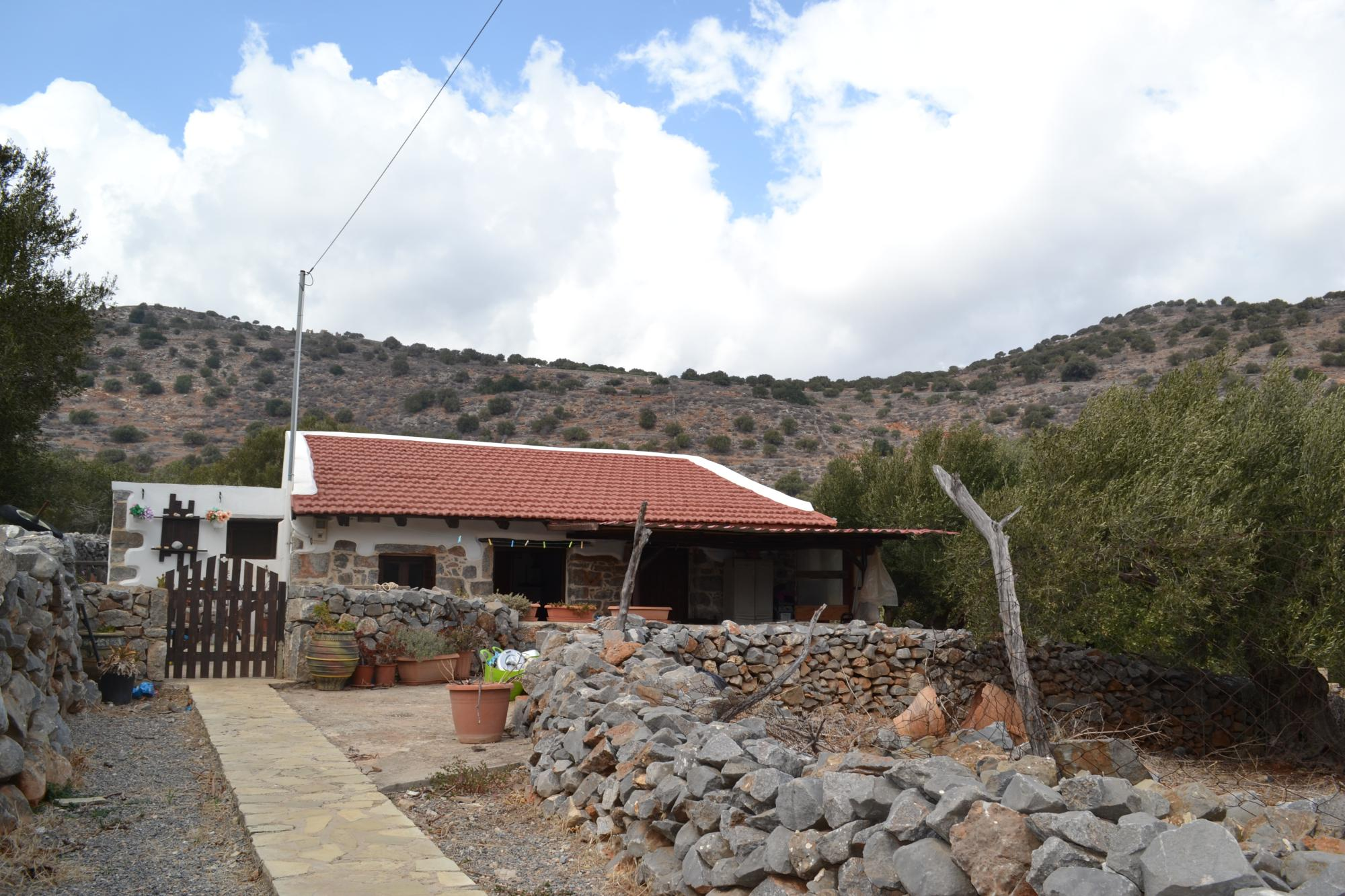 One bedroom stone cottage on private land near Elounda. Garden.