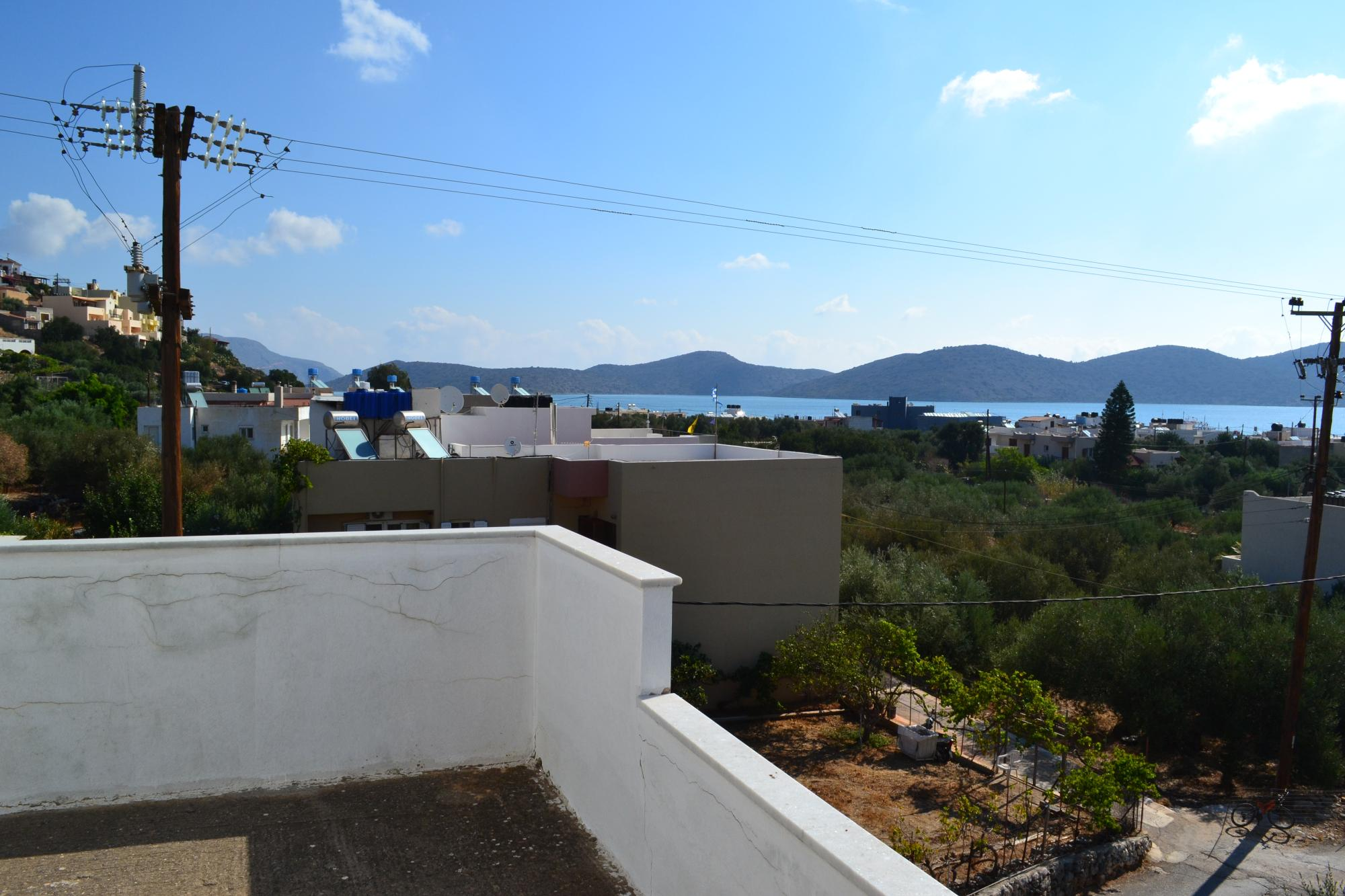 Modern, unfinished, three bedroom sea view apartment in Elounda.