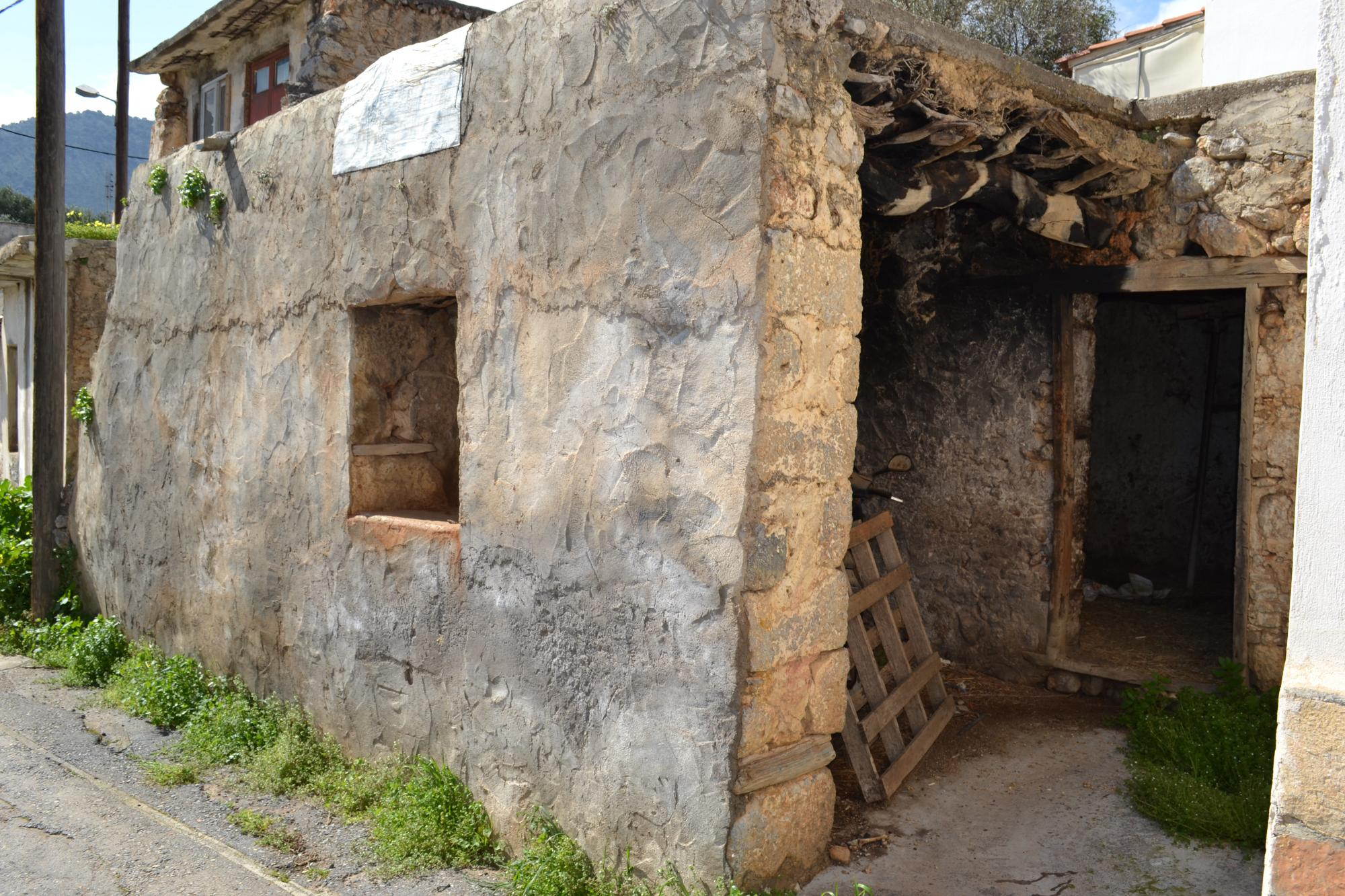 Stone house for renovation in traditional village close to town and beaches.