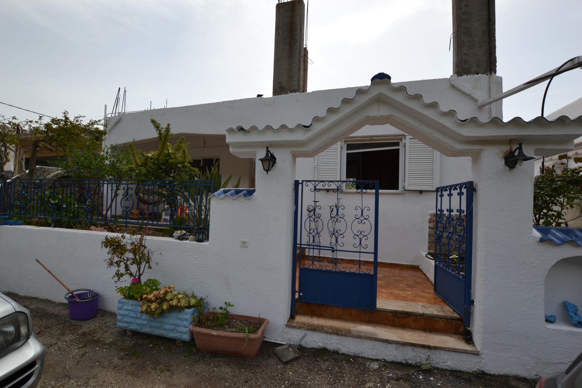Large house for sale with small garden in beautiful village.