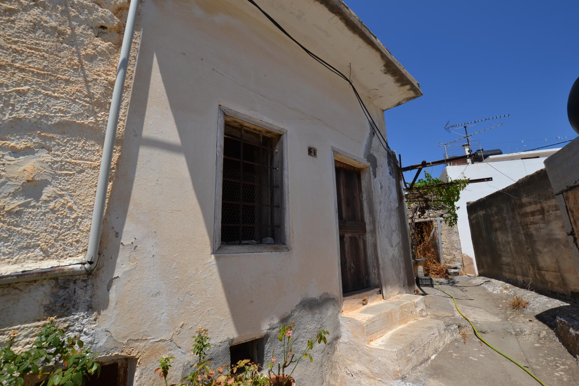 Stone house for renovation in top part of village. Sea views from roof terrace.