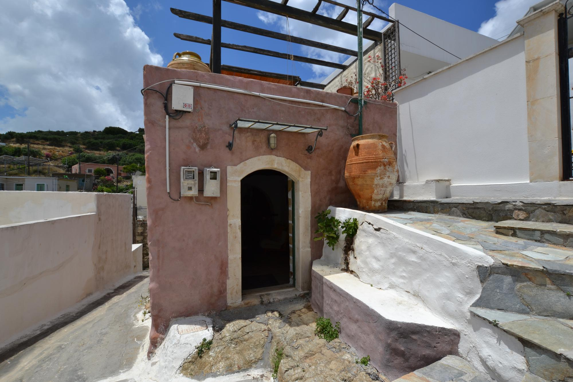 One bedroom stone villa in traditional village plus plot of land.