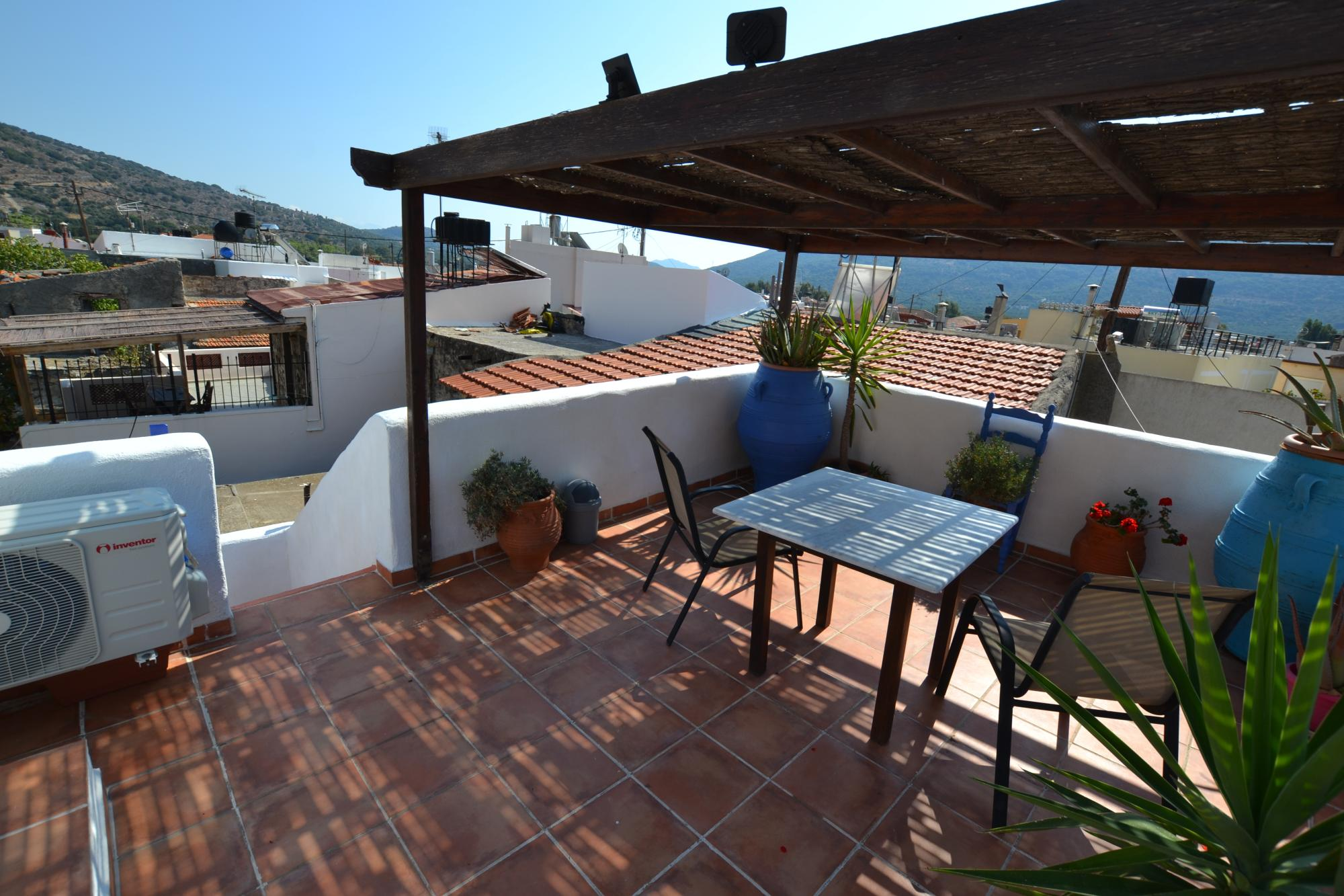 Spacious two bedroom village house with large roof terrace. Fully furnished.
