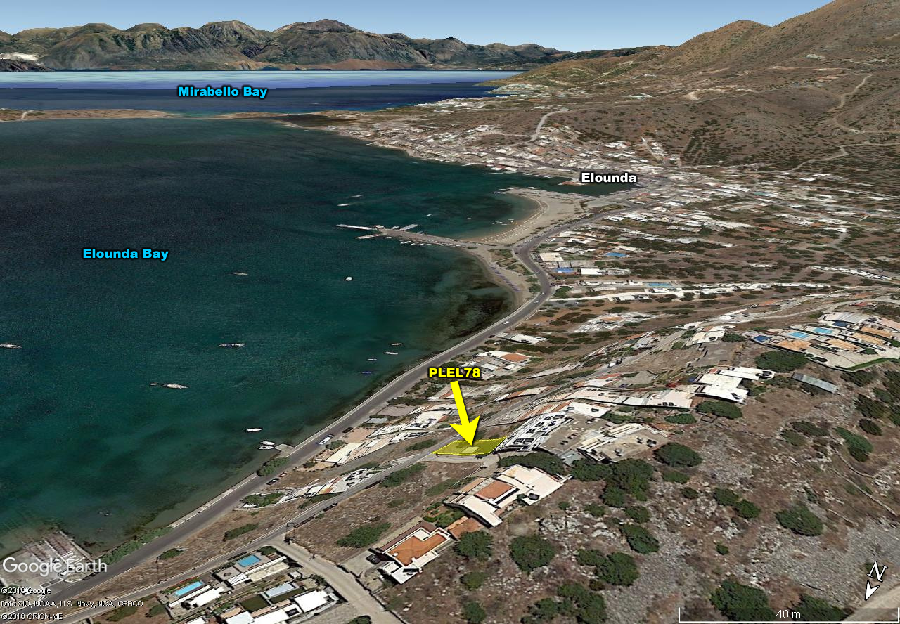 Seaside plot with unobstructed sea views in the elite tourist resort of Elounda