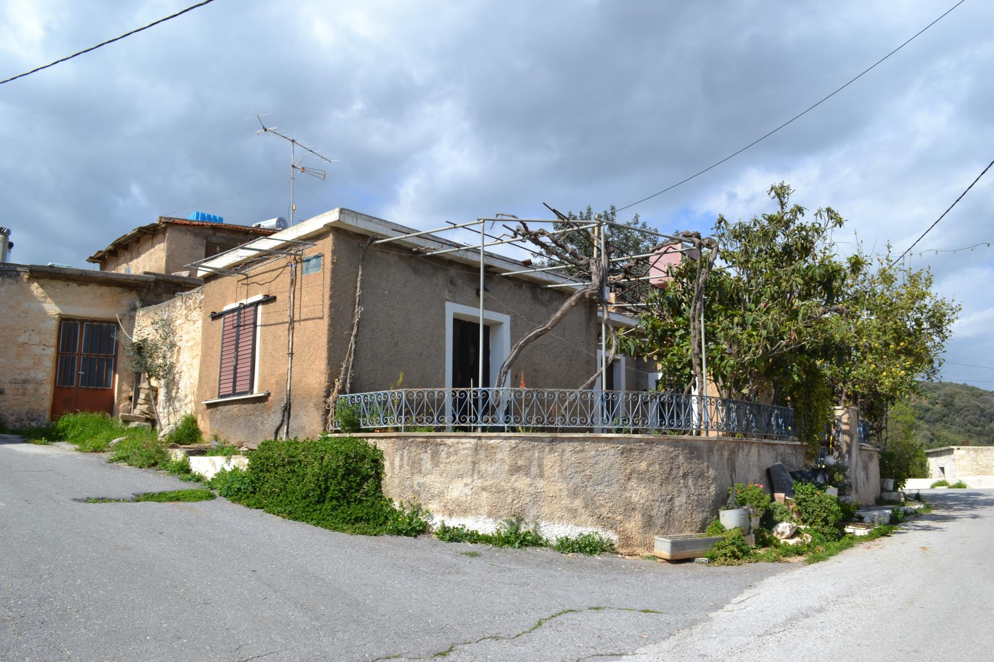 Large house for renovation with courtyard and nice views from balcony.