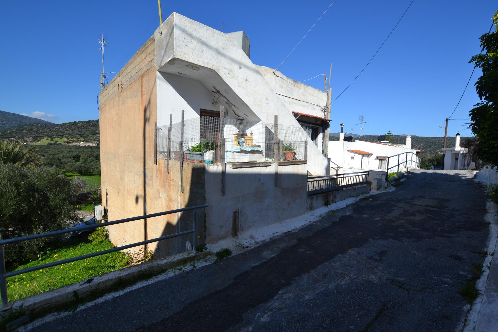 Top floor apartment for sale near the town of Agios Nikolaos.