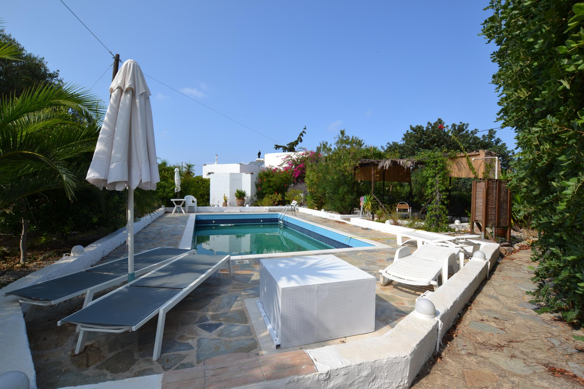3 Cretan-styled detached houses with pool, walking distance to beach. Sissi