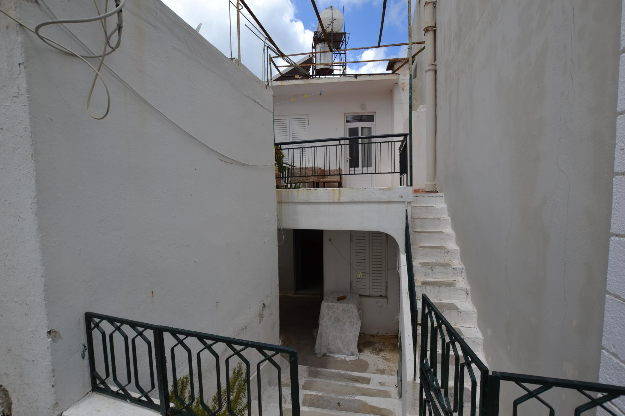 2 bedroom village house with large balcony and terrace.