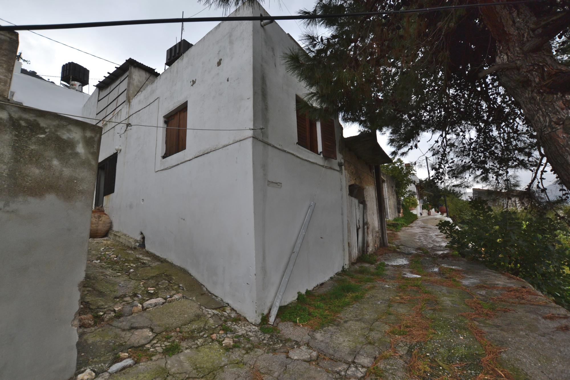 7 room property for renovation with great views and garden.