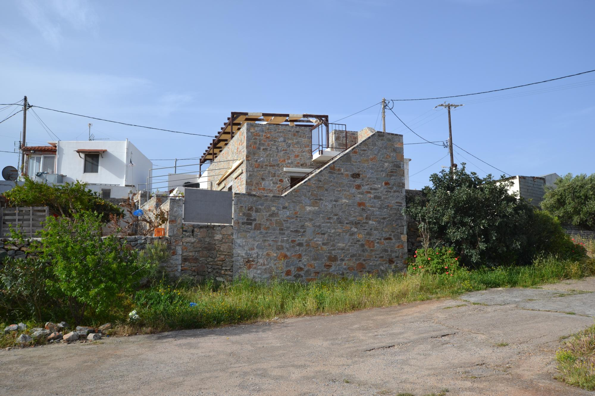 Restaurant with guest room in traditional village with sea views from roof terrace.