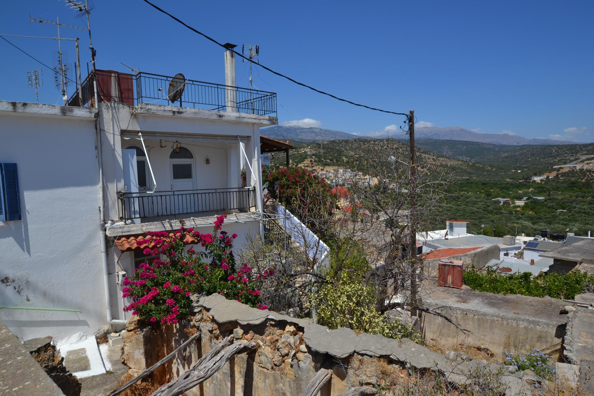 House for renovation with sea views from balcony and roof terrace.