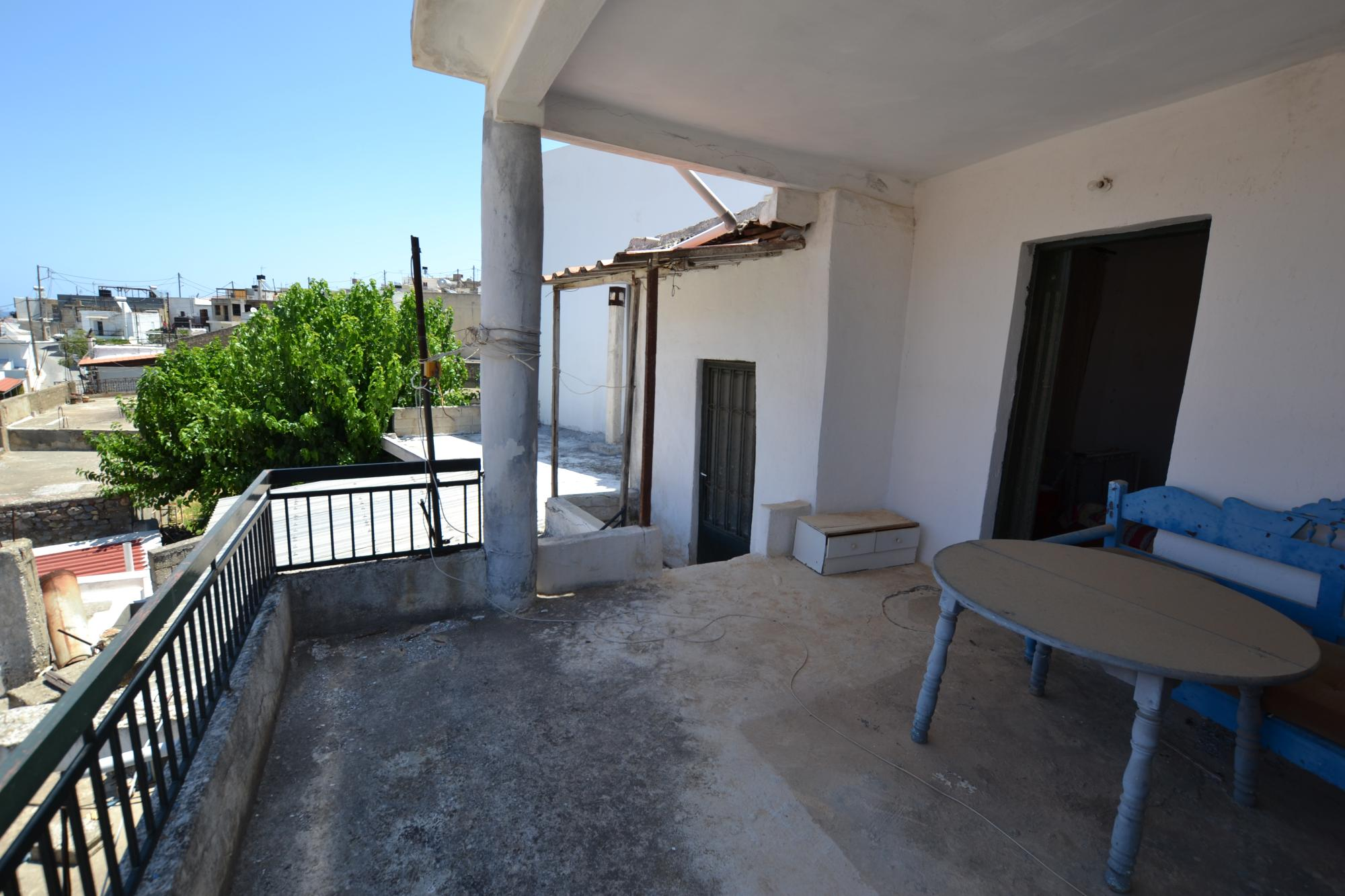 House for renovation with sea views from large balcony.